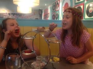 Children sharing a dessert