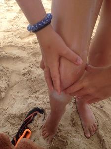 Applying Nivea Sun Tan Lotion